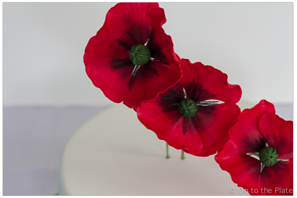 Gumpaste poppies made using Bakels Red fondant with tylose.